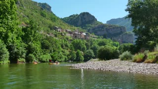 People with kayak on river Tarn in southern France. View of the Gorges du Tarn, beautiful French natural landscape with canyons, mountains, forest, crystal clear water