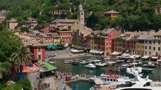 View of Portofino in Liguria, Italy. Beautiful and famous Mediterranean sea village in the Italian Riviera. Tourist destination, landscape, buildings, summer holidays, vacation in Europe, harbor