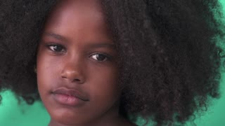 Portrait of Cuban children with emotions and feelings. Black young girl from Havana, Cuba looking at camera with worried face, female child with sad expression. Close-up