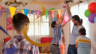 Portrait Of Happy Hispanic Child Smiling At Birthday Party