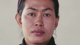 Portrait of real Asian people, with emotions and feelings, looking at camera. Cheerful woman from Cambodia, Asia