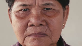 Portrait of real Asian people, with emotions and feelings, looking at camera. Grandmother, senior woman from Cambodia, Southeast Asia
