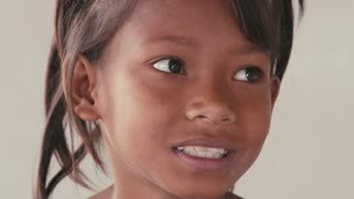 Portrait of real Asian people, with emotions and feelings, looking at camera. Happy little girl from Cambodia, Asia smiling