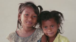 Portrait of real Asian people, with emotions and feelings, looking at camera. Happy little girls from Cambodia, Asia smiling