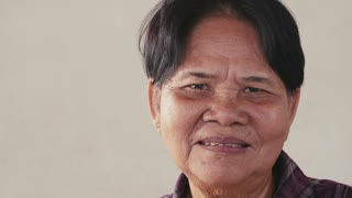 Portrait of real Asian people, with emotions and feelings, looking at camera. Happy old woman from Cambodia, Asia smiling