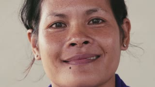 Portrait of real Asian people, with emotions and feelings, looking at camera. Happy young woman from Cambodia, Asia smiling