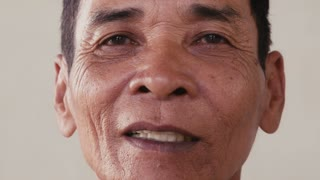 Portrait of real Asian people, with emotions and feelings, looking at camera, seniors. Serious old man from Cambodia, Asia. Closeup of face