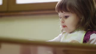 Preschooler eating lunch in classroom, baby girl, child, school, food, nutrition and education
