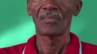 Real Cuban people and emotions, portrait of sad senior hispanic man looking at camera. Worried old black grandfather with mustache and hat from Havana, Cuba. Close up of face