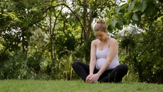 Relaxed pregnant woman, mom doing yoga in park, motherhood