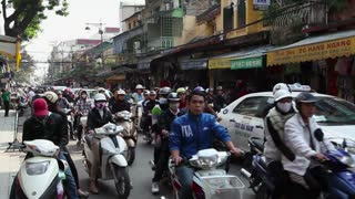 Scooters, motorcycles, bicycles, traffic and people in the streets of the Old Quarter, Hanoi, Vietnam, Asia. Multiple shots with original sound
