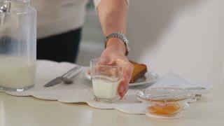 Senior woman at home, drinking milk