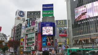Shibuya district, Tokyo, Japan, Asia. View of the Japanese city with Asian people, modern buildings, neon lights, signs, billboards, advertising. Famous landmark and tourist spot, travel attraction