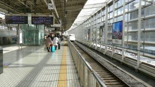 Shinkansen bullet train in Kyoto JR railway station, Japan, Asia. Modern transportation, fast travel, Japanese travelers and Asian commuters on platform