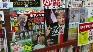 Shop, store selling comics, books, anime magazines in shopping mall, Hiroshima, Japan, Asia. Close-up of magazine cover with US president Donald Trump