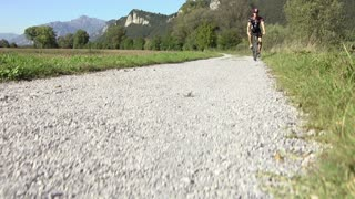 Sports activities, young adult cyclist riding mountain bike and text messaging on mobile phone
