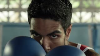 Sports and people, young latino man training in boxing gym. Slow motion