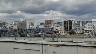 The city of Himeji in Kansai, Japan, Asia seen from the Shinkansen bullet train. Architecture, buildings, Japanese urban landscape