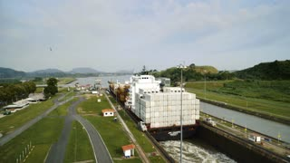 Time-lapse of Panama city, boat, cargo ship, containers, canal