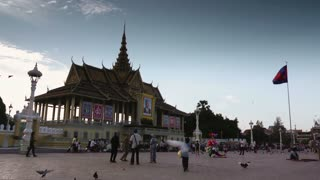 Tourists and people walking in the square in front of the Royal Palace, Phnom Penh, Cambodia