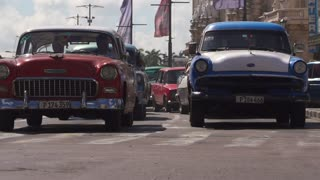 Traffic With Old Cars And Taxis In Havana Cuba