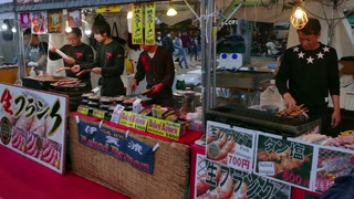 Ueno Park, Tokyo, Japan, Asia. Japanese people, tourists and small business, family-run stall selling traditional Asian street food at fair