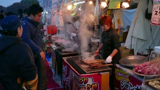 Ueno Park, Tokyo, Japan, Asia. Japanese people, tourists and small business, family-run stall selling traditional street food at market, city fair