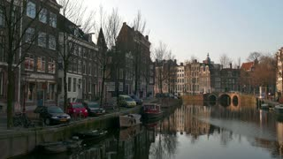 Urban landscape, city view of Amsterdam, The Netherlands, Holland, Europe. Traditional buildings, homes, houses, architecture and water canal
