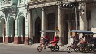 Urban Traffic In Havana Cuba With Bicycle Taxi And Cars