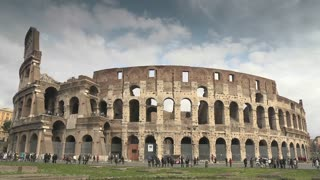 Urban view of Rome, Italian capital city with old buildings, monuments and art: the Colosseum