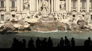 Urban view of Rome, Italy, capital city with old buildings, monuments and art. Trevi Fountain, Fontana di Trevi, Roma, Italia