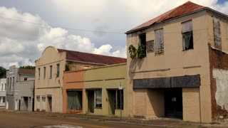 Old abandoned buildings in downtown Natchez, Mississippi, United States of America. Economic crisis and depression with empty businesses, shops, stores and homes