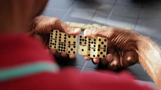 Active Retired Senior Man Playing Domino Game With Friends