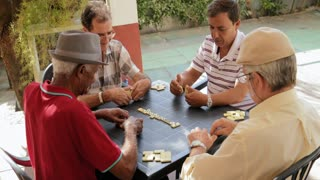 Active Retirement With Happy Old Friends Playing Domino Game