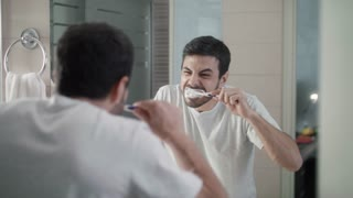 Adult Man Fast Brushing Teeth Is Late for Work