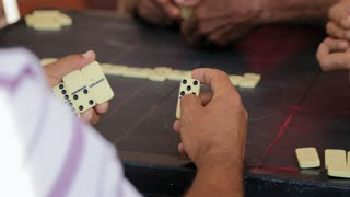 African American Old Man Playing Domino With Friends
