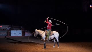 American cowboy performing rope show on horse at rodeo in Cowtown Coliseum, arena in the stockyards of Forth Worth, Texas, United States of America