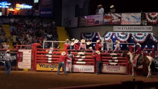 American cowboy riding horse at rodeo in Cowtown Coliseum, arena in the stockyards of Forth Worth, Texas, United States of America. Men and animals at sport event
