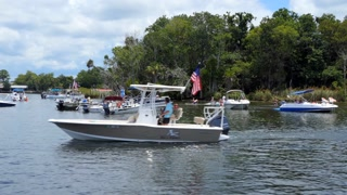 American people celebrating the 4th Of July (Independence Day) in Crystal River, Florida, USA with boats in local river