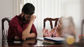 Anger And Frustration For Father And Daughter Doing School Homework