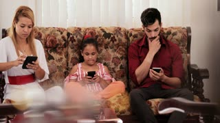 Angry Girl Explaining The Use Of Mobile Phone To Parents