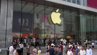 Apple Store in the pedestrian street of East Nanjing Road, Shanghai, China, Asia. People and tourists walking in downtown area