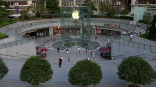 Apple Store, mall, banks and shops in the financial district of Pudong in Shanghai, China, Asia. Asian people and tourists walking and shopping