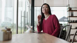 Asian Business Woman Working In Bar Outside Office