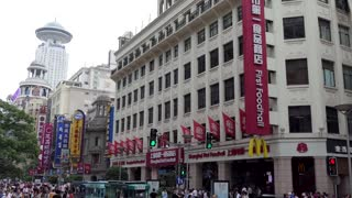 Asian people and Chinese tourists shopping in the pedestrian street of East Nanjing Road, Shanghai, China, Asia. Urban life with shops and department stores in downtown area