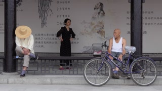 Asian people relaxing in Tianshui city square, Gansu province, China, Asia. Daily life in Chinese town with local men and women