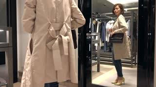 Asian people shopping for fashion goods and accessories. Confident Japanese woman smiling in luxury shop inside mall. Happy lady buying new leather bag in store and looking at mirror