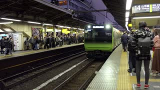 Asian people, tourists and Japanese commuters waiting for a local train arriving at Shinjuku JR station in Tokyo, Japan, Asia. Railway, transport, transportation, travel