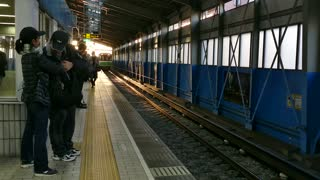 Asian people, tourists and Japanese commuters waiting for a train arriving at subway station in Osaka, Japan, Asia. Railway, transport, transportation, travel