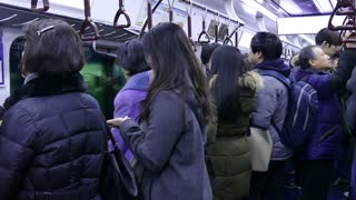 Asian people, tourists and Korean commuters waiting for subway train arriving in undergound station in Seoul, South Korea, Asia. Railway, transport, transportation, travel
